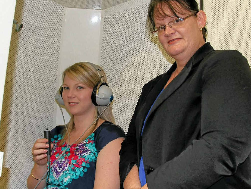 Katie Kenzler of the Warwick National Hearing Care centre and senior audiometrist Tammy Murray show off their hearing test booth.
