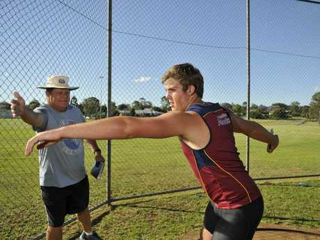 Matthew Denny and coach Grahame Pitt going through a training drill in 2013.