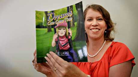 Author Julie Laird with her new book dedicated to her daughter, Samantha.