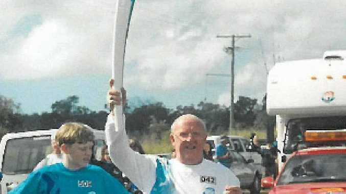 John Rogers, when he carried the torch in the 2000 Olympic torch relay.