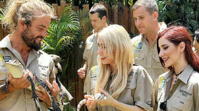 THRILLS: Xavier Rudd with The Veronicas' Jess and Lisa Origliasso help with Australia Zoo's Steve Irwin Day.