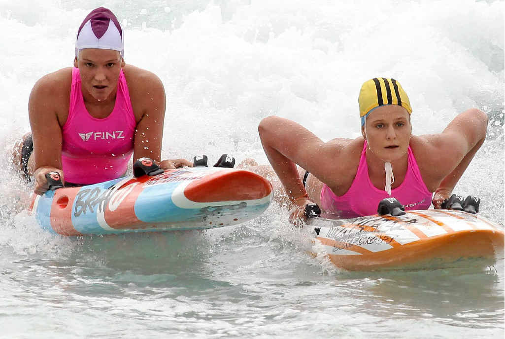 SHOULDER TO SHOULDER: Alyssa Bull, right, holds a slight edge on Maddy Dunn in the under-19 ironwoman final at the Maroochy Surf Classic yesterday.