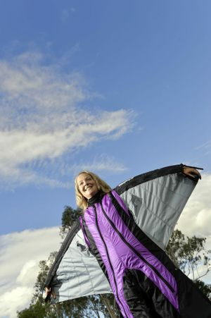 Kirsten Moriarty poses in her sky diving gear. Ms Moriarty has written a book on a sky diving accident she had in 2010 and her subsequent recovery. Photo: Claudia Baxter / The Queensland Times