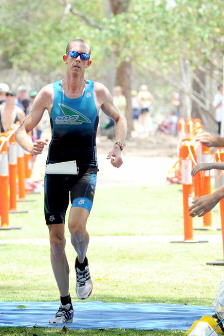 Collecting third place in the open male race, Steven Schofield.