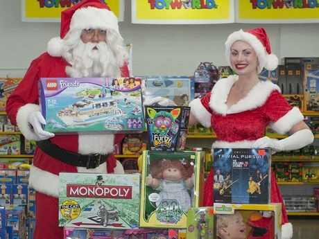 Santa and his helper with Toyworld's top 10 toys of all time.