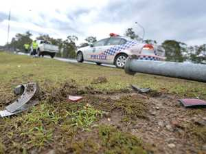Man escapes injury after crashing into light pole