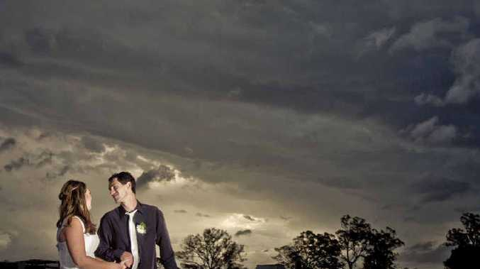 SILVER LINING: Josi Saint and Jean-Pierre De Graaf underneath storm clouds at Lawrence after their wedding. PHOTO: ADAM HOURIGAN