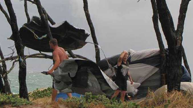 SCARY STUFF: Campers at Inskip Point struggle to keep hold of their tent as it almost blows away in high winds on Saturday.