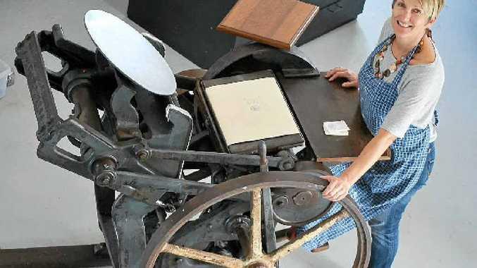 DEBOSS: Sabine Pick in her Byron Bay studio with her 1936 C&P; platen letterpress.