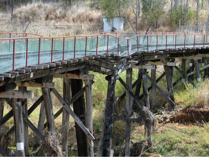 HAZARD ZONE: The old railway bridge spanning the Dee River in Mount Morgan will soon be demolished as it is now in an unsafe state of repair.