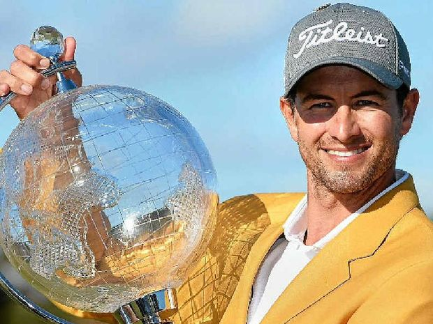 SUCCESS: Adam Scott poses with the trophy after winning the Australian Masters.