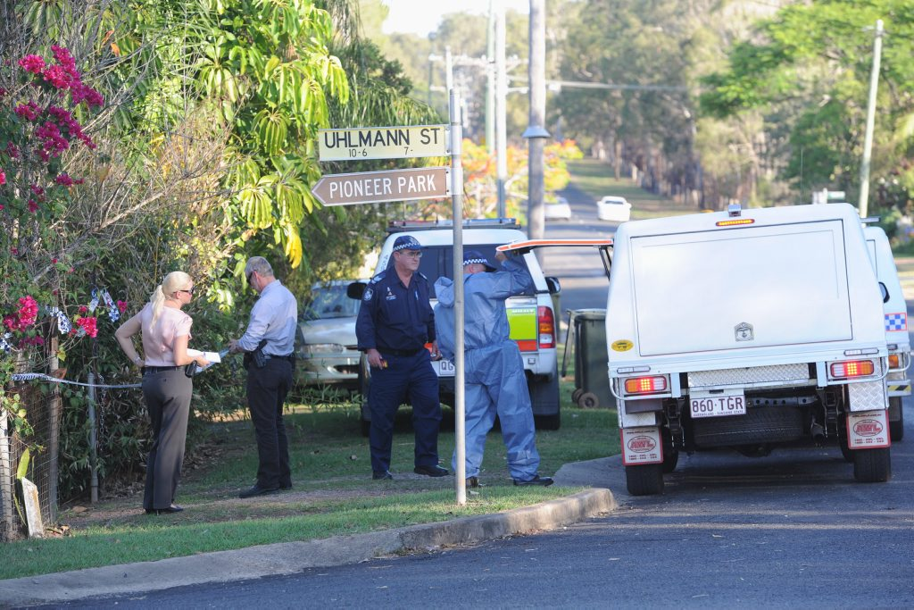 Police and forensic officers at a house on the corner of Uhlmann St and Woongool Rd, Tinana.