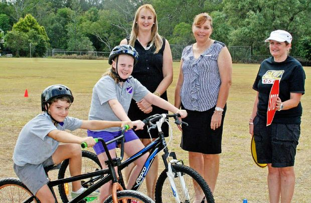 SAFE RIDING: (From back left) Ipswich City Council City Infrastructure Committee chairwoman Cr Cheryl Bromage, Churchill State School Principal Jodie Jones, Sue Miles from the 24/7 Cycling Safety Fund and Churchill State School students (from front left) Aaron Hill and Madisyn Griffiths.