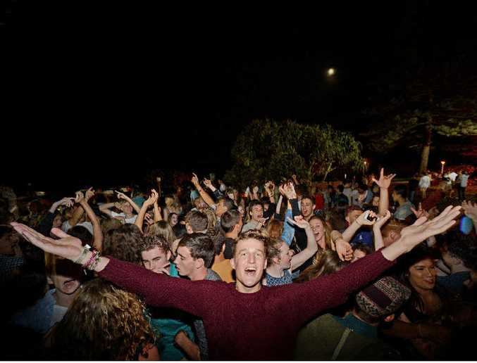 ON THE BEACH: Connor Bath, 18, of Tamworth, and friends enjoying the free music at the Red Frogs Schoolies tent in the park at Main Beach, Byron Bay, on Monday night.