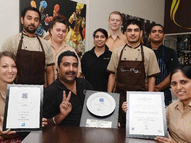 Spice N Flavor staff (back, from left) Navjot Singh, Ake Kura, Gagan Khehra, Harry Clark, Gurpreet Singh, Arun Arun, (front) Lisa Cimma, Amani Khehra and Seema Rani celebrate their awards.