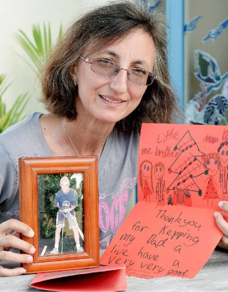 Rosemary Haines with a photo of her son Phillip and a Christmas card from the family of a man who received a kidney.