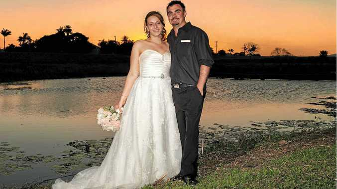 Brooke and Rick Ludkin are pictured under a cloudless sky on their beautiful wedding day.