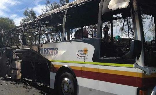 Up to 20 passengers were evacuated from this bus when it burst into flames on the Warrego Hwy near Helidon.