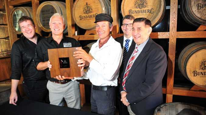 TOP DROP: Graham Wrigglesworth, David Halliday, Marty Woods, Keith Pitt and Mal Forman with the 125th Anniversary Rum. Photo: Max Fleet / NewsMail