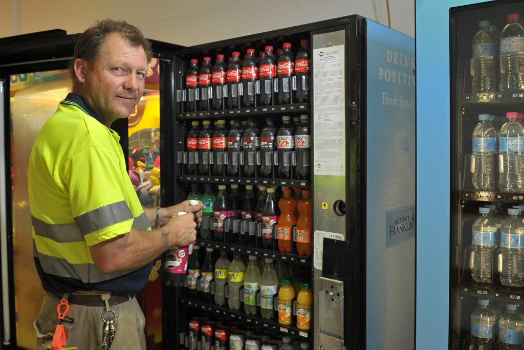 BUSINESS FIZZING: Michael Watson increased the turnover of his two-day-a-week vending machine business by 170%, seen here stocking up Stockland for Christmas.