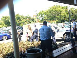 Man wielding knife at shopping centre taken away by cops