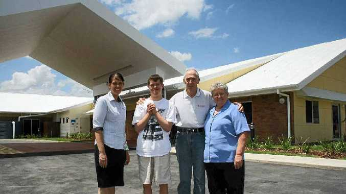 NEW HOME: Assistant co-ordinator for centre-based respite care Christine Groves and Blue Care Lockyer Community Care service manager Elaine Horrocks with clients Daniel Butler and Dean King in front of the new building.