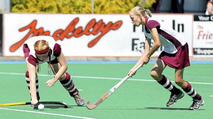 STATE HONOURS: Ellynie Cameron (right) was chosen in the state indoor team. She is already a proven performer in representative field hockey and cricket. PHOTO: SHANE SEDGER