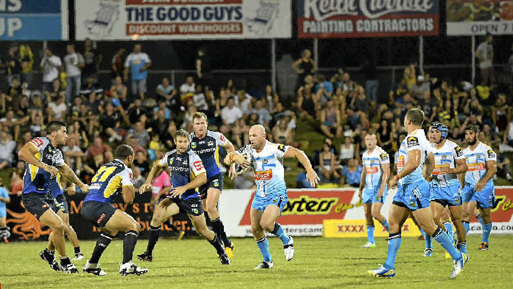 The Titans' Luke Bailey takes on the Cowboys defence in the Mackay trials earlier this year.