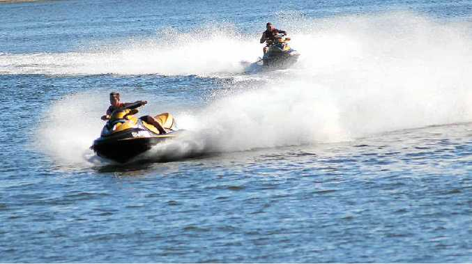 FEARS FOR FUTURE: Jetskiers tear along Pumicestone Passage. An action group has called for tighter controls as a first step to protecting the waterway.