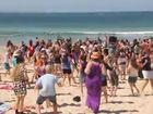 VIDEO: Schoolies 'flash' unsuspecting crowds at Noosa