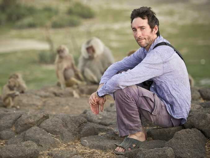 Australian biologist Mat Pines with Hamadryas baboons in Awash National Park.