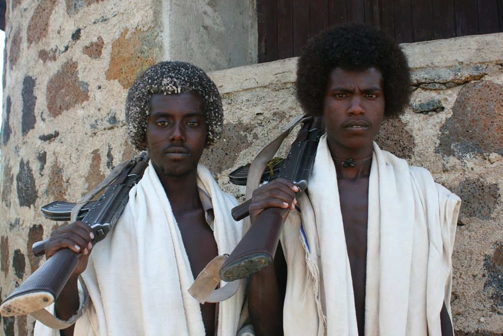 Two Afar tribesmen pictured with guns in a scene from the TV documentary Living With Baboons. Supplied by Network Ten.