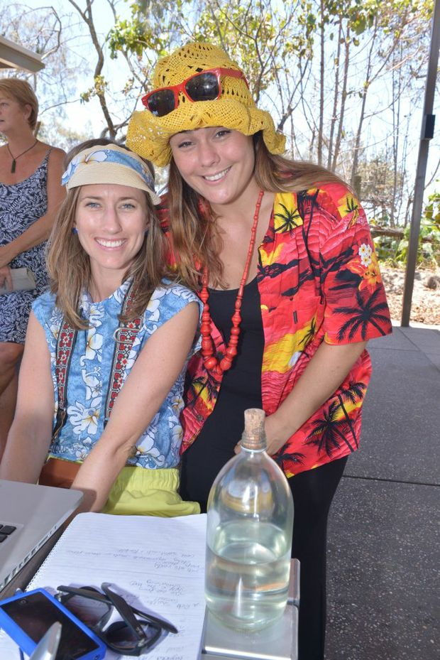 Elise Reilly and Yvette Adams at Mooloolaba Beach for National Telework week. Photo: John McCutcheon / Sunshine Coast Daily