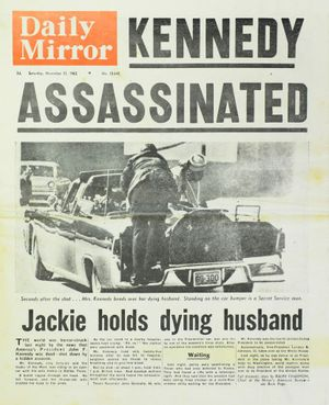 Cr Paul Tully has collected several original newspapers from 1963 covering the assassination of JFK. Photo: David Nielsen / The Queensland Times
