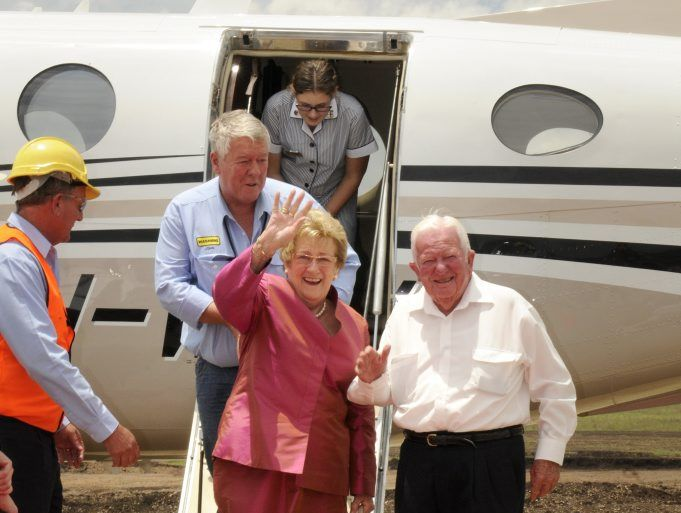 The historic first plane flight into Wellcamp Airport was piloted by Wagners chairman John Wagner (back) yesterday, with parents Henry and Mary Wagner among the handful of passengers.