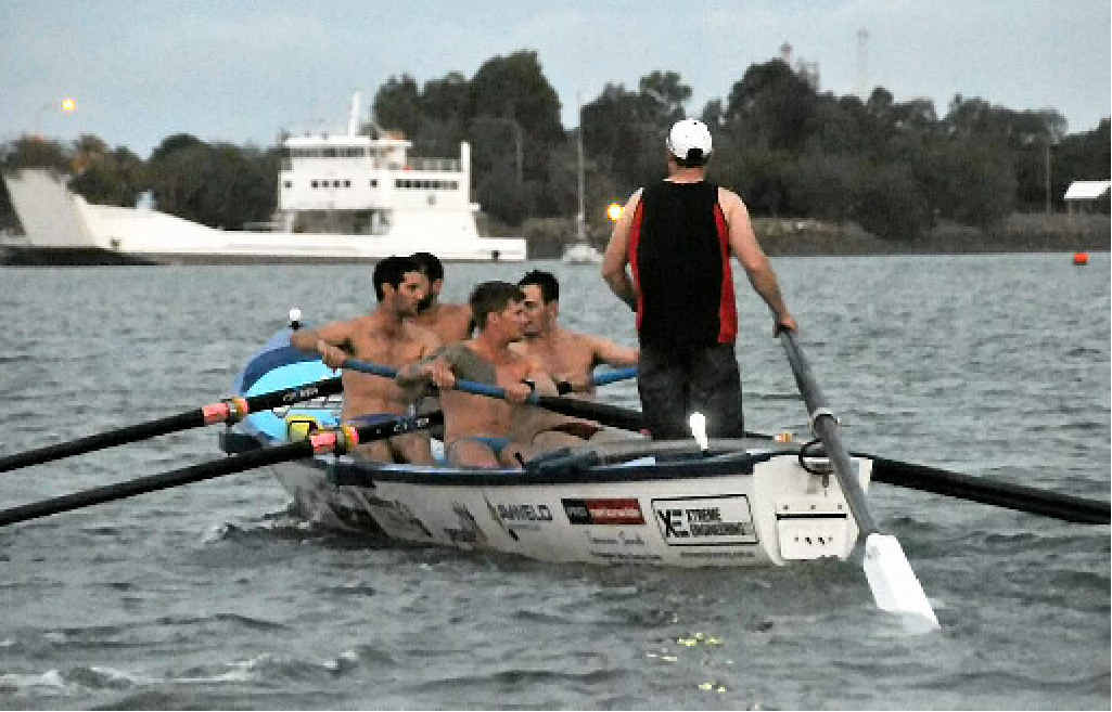 HEAVE HO: Tannum SLSC's Open Men's team the 'Hellfish' row out on a training row as the light fades fast.