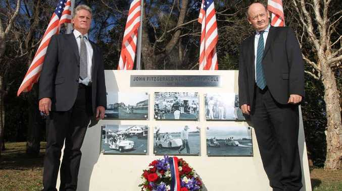 Palmer Coolum Resort assistant general manager Simon Stodart and general manager Bill Schoch at the resort's JFK memorial for the 50th anniversary of the assassination of the former US president.