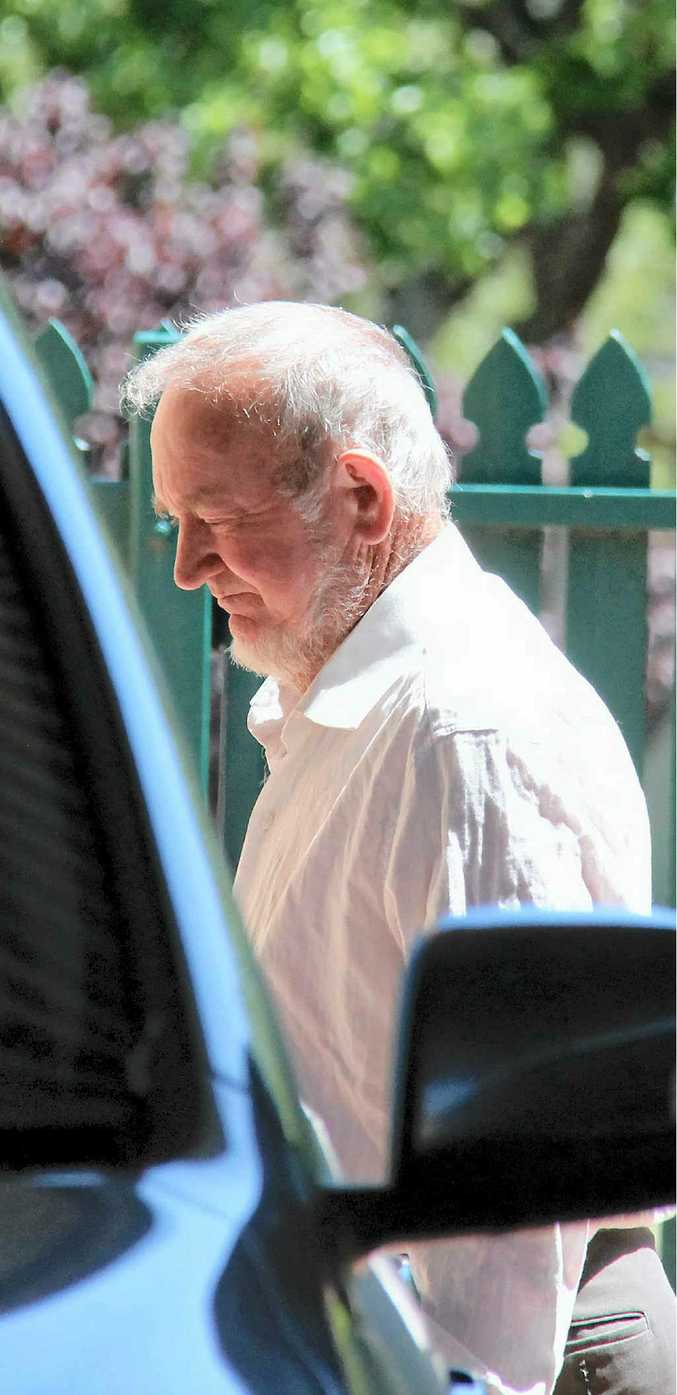 Bill Lynam walks from the watchhouse into the Warwick Magistrates Court.