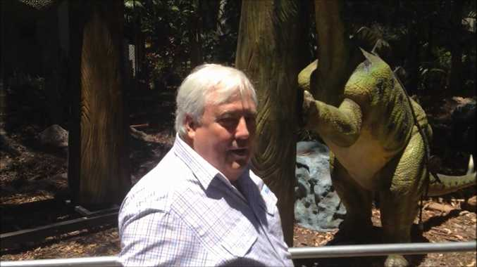 Clive Palmer shows off the Palmersaurus to some reporters.