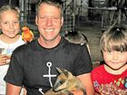 ANIMAL MAD: Childers vet Duncan Smith with daughter Harriet and son Monty, along with Darth Vader the rat, Fatso the corella and Wally the swamp wallaby.