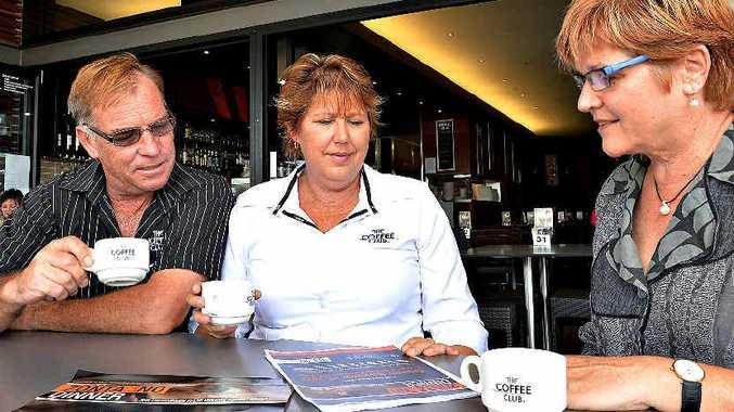 The Coffee Club owners Dan Davis and Carol Brooks meet with Zonta Mackay president Bridget Mather to plan Saturday night's awareness dinner.