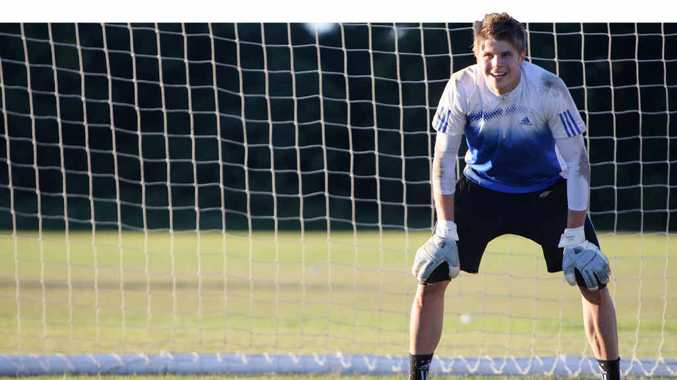Former Emerald goalkeeper Mitch Langerak, selected for the Socceroos, trains in goal.