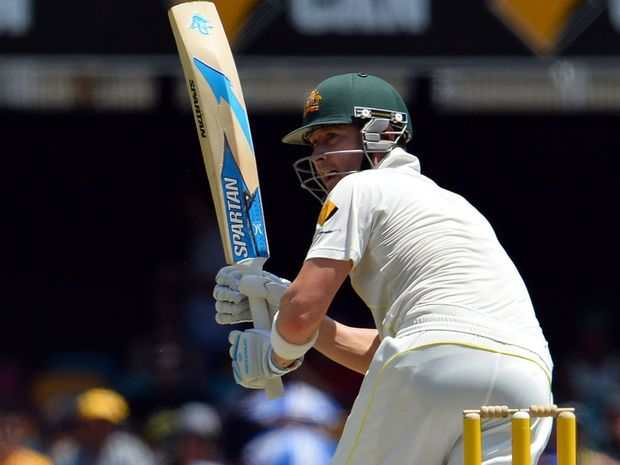 Australian batsmen Michael Clarke plays a shot during day three of the first Ashes cricket Test match between England and Australia at the Gabba Cricket Ground.
