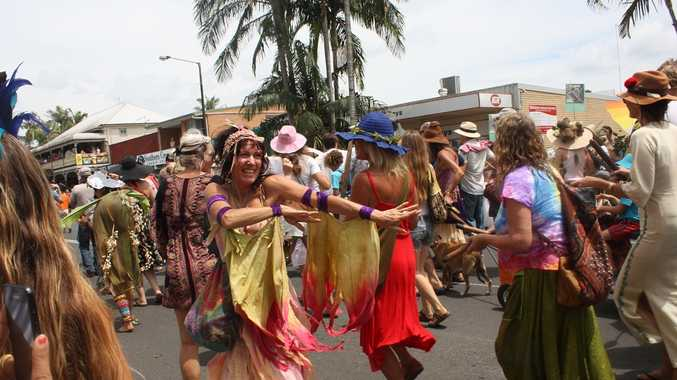 Mullumbimby locals celebrate the final day of Mullum Music Festival by parading through the town.