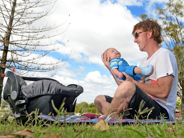 John Gass shows off his son Connor at Jack Evans Boat Harbour.