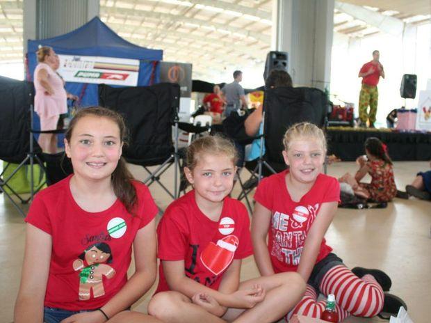 Elizabeth Smith, Gemma Smith and Carissa Smith at the Rockhampton Special Children's Christmas Party. Photo Lisa Benoit / The Morning Bulletin