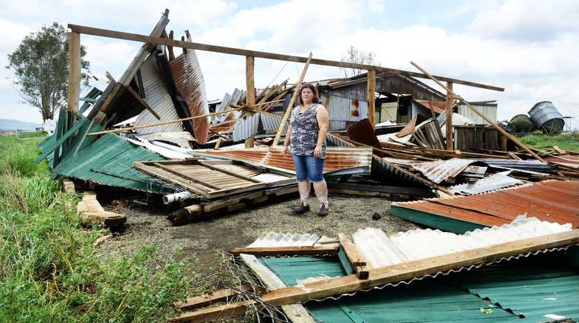 TORN APART: Shiralee Winslade inspects the damage to a shed in Lower Mt Walker after storms on Saturday night.