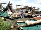 Tornado tears off roofs as families cower