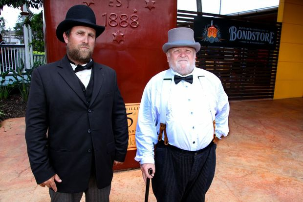 BLAST FROM THE PAST: Geoff Atkinson and Bob Lane in time period costumes in celebration of the 125th Anniversary of the Bundaberg Distillery Company held at the Bundaberg Distillery. Photo: Zach Hogg / NewsMail