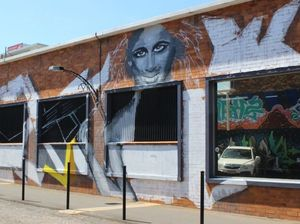 Vandalise me please! Dreary wall gets modern makeover